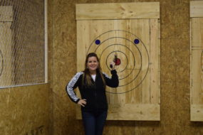 Heather hits a bullseye at Stick It axe throwing